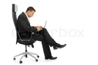 Businessman with a laptop sitting in a chair in a bright office Isolated on white background