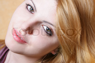 Face of young pretty woman close-up