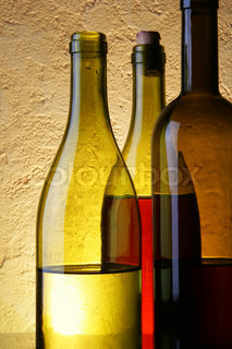 Still-life with three wine bottles close up