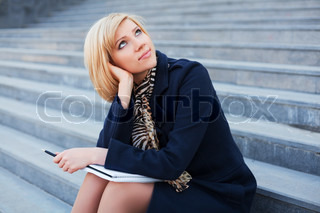 Young businesswoman with notebook