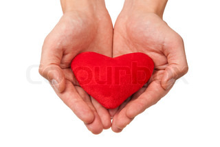 Red heart in man's hands isolated on white