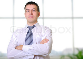 Young business man in the office workplace