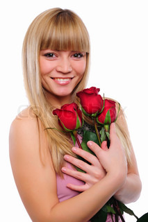 portrait of young charming girl with a bouquet of roses Valentine's Day
