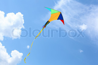 wind kite flying in the blue summer sky