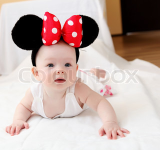 portrait of little baby with big mouse ears