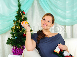 Portrait of a young pregnant girl with a gift in their hands
