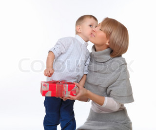 mother and son sitting on the floor and holding a present box