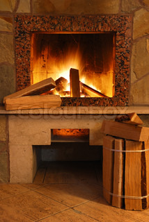 Fireplace Flaring fire in a fireplace the reveted wild stone and a marble