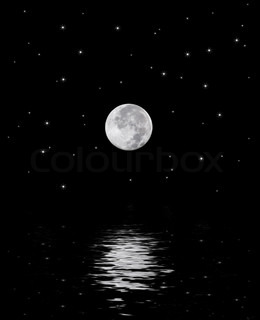A beautiful harvest moon over a star filled sky reflecting off the water