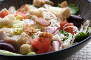 A delicious looking tossed chefs salad or antipasto with meat cheese and croutons