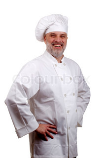 Portrait of a happy chef in a chef's hat and uniform isolated on a white background