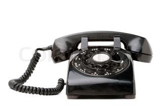 En gammel sort vintage roterende stil telefon isoleret over en hvid baggrund