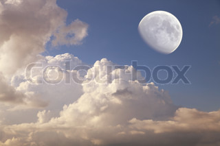 big moon in the daytime sky with clouds