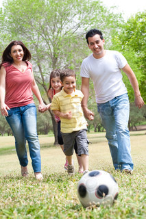 Family outdoor,playing football and having fun