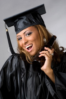 A recent graduate posing in her cap and gown holding beer bottle isolated over a silver background