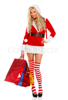 beautiful blond woman in christmas costume with shopping bags, isolated on white background