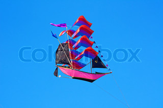 Traditional balinese kite: the flying ship on the blue sky background