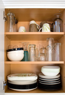A full cabinet full of dishes and plates