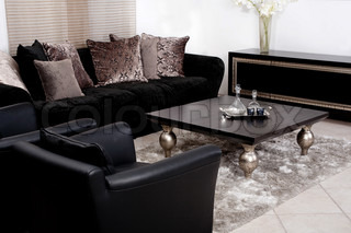 moderne schwarze stoff couch wohnzimmer stock foto colourbox. Black Bedroom Furniture Sets. Home Design Ideas