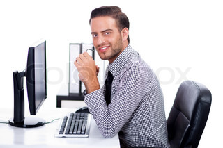 Business man smiling at you in the office over white background