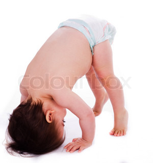 Baby bending down frontwards on isolated background