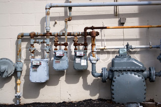 Old Natural Gas Utility Pipes And Meters In An Urban