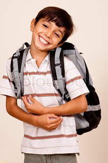 A cute school boy with back pack isolated on ivory background