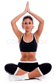 Girl sitting in yoga posture on isolated white background