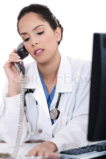 Asian female doctor talking over phone in isolated white background