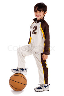 Cute junior boy basket ball player leg over the ball on isolate white background