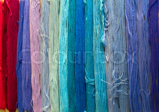 yarn background in shades of blue and red