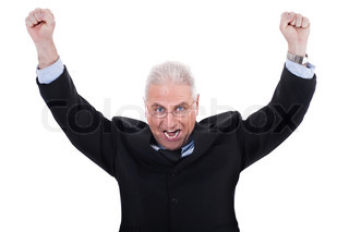 Champion senior business man standing with fists clenched in victory in white background