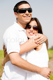Portrait of Romantic couple hugging passionately at the park,outdoor