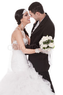 Happy bride and groom on their wedding day over white background
