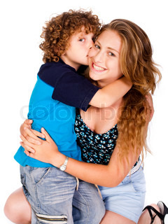 Young kid kissing his mom and looking at camera, isolated on white