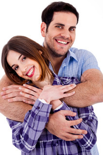 Closeup portrait of a cute young man hugging his wife from behind