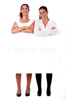 full length of young business women's with their hands folded on isolated white background