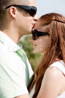 Closeup Portrait Of A Cute Couple Hugging, the men kiss the women