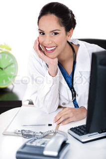 Doctor smiling at the camera over white background