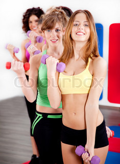 image of ladies working out with dumbbells in gym