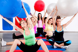 image of people doing stretching exercise with fitness balls