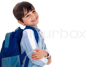 Happy young boy ready for school with his bag on isolated white background