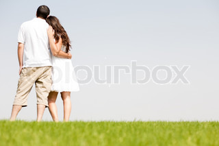 young couple hug, park