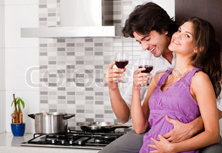 honeymoon couple drinking wine in kitchen
