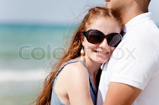 Closeup Portrait Of A Cute Couple Hugging , Focus On Female
