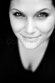 Close up of a beautiful young womans face with a friendly smile Shallow depth of field