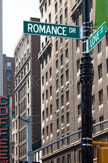 A sign post at the intersection of two streets reading ROMANCE DR and LOVE ST Or remove the words and insert your own to easily customize the concept