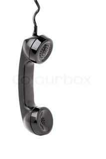 Nærbillede af en gammel vintage telefon håndsæt hang i en akkord isoleret over en hvid baggrund