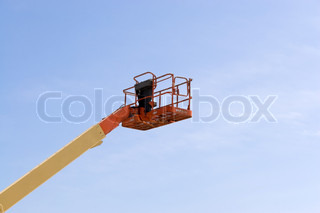 A modern cherry picker or lift for use in commercial construction or painting