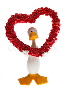 figurine of a duck with hearts on white